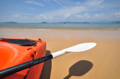 Close-up side of kayak boat with paddle on tropical beach background Royalty Free Stock Images