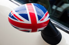 Close up on a side mirror of a car with the UK flag on it. Stock Photo