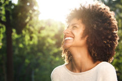 Close up portrait of beautiful confident woman laughing in nature stock photography