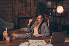 Close up side profile photo beautiful she her business lady chief hard week weekend speak skype legs table look. Satisfied notebook overjoyed sit office chair stock images