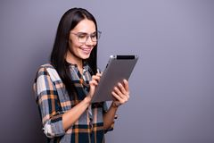 Close up side profile photo beautiful she her lady hold hands arms e-reader clever eyes look screen device learn lessons. Classes information wear casual stock images