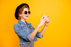 Close up side profile photo foxy she her lady modern telephone make take selfies speak tell skype wear specs vintage hat. Casual striped t-shirt jacket jeans stock photos