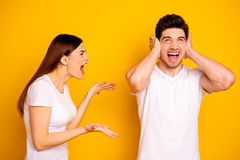 Close up side profile photo two beautiful people she her he him his blame yell fault aggression look up hide ears palms. Hands arms not listen wear casual white royalty free stock photos
