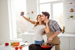 Close up side profile photo two people beautiful he him his macho she her lady telephone hands make take selfies make royalty free stock images