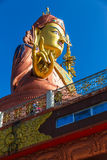 Close up at the side Statue of Guru Rinpoche, the patron saint of Sikkim that view at the base from front and below. Royalty Free Stock Image