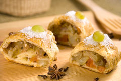 Close up side view of apple Strudel. Apple Strudel on a wooden table Royalty Free Stock Photography