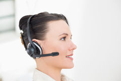 Close up side view of a beautiful businesswoman using headset Royalty Free Stock Image