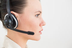 Close up side view of a beautiful businesswoman using headset Stock Photos