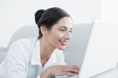 Close up side view of a beautiful woman using laptop Stock Photos