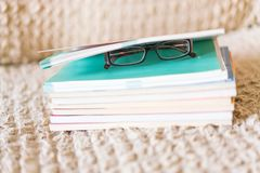 Close up side view book with glasses royalty free stock images