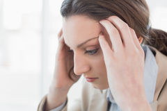 Close up side view of businesswoman suffering from headache Royalty Free Stock Photo