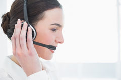Close up side view of businesswoman wearing headset Stock Image