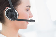 Close up side view of businesswoman wearing headset Stock Photos