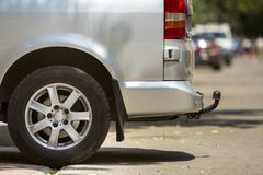 Free Close-up Side View Detail Of Silver Passenger Medium Size Luxury Minibus Van With Tow-bar Parked On Summer Sunny City Street Royalty Free Stock Images - 134982929