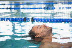 Close-up side view of a fit swimmer in the pool Stock Photos