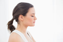 Close up side view of a fit young woman with eyes closed Stock Photo
