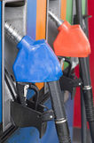 Close up side view fuel nozzle fuel oil gasoline at petrol filli Royalty Free Stock Image