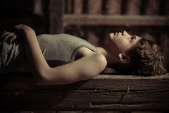 Free Close Up Side View Of Boy Laying On Wooden Bench Royalty Free Stock Photos - 95577858