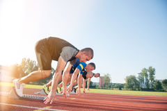 Free Close-up Side View Of Cropped People Ready To Race On Track Field Royalty Free Stock Photography - 80821197