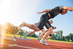 Free Close-up Side View Of Cropped People Ready To Race On Track Field Royalty Free Stock Photo - 80823645