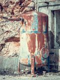 Close up side view of old rusted metal tank in abandoned industrial area. royalty free stock photo
