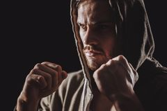 Close up side view photo of masculine sportsmen with tough look. royalty free stock images