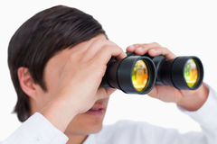 Close up side view of tradesman with spy glass Royalty Free Stock Photos