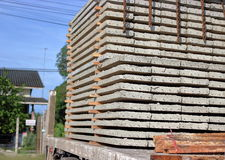 Close up side view of truck while load stack of prestressed concrete slabs for construction stock image