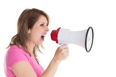 Close up side view of woman shouting into bullhorn Stock Photography