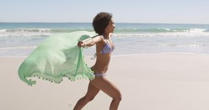 Young woman running at the beach 4k