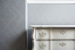 Close-up of sideboard. Close-up of retro style white sideboard in the corner Stock Photos