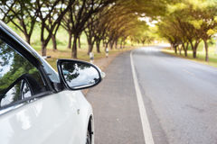 Close up Sideview mirror white cars beside Royalty Free Stock Photo