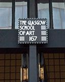Close up of sign at the entrance to the Glasgow School of Art building, designed by architect Charles Rennie Mackintosh. Glasgow, Scotland, UK. Close up of sign stock photos