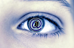 At sign in a woman eye Stock Image