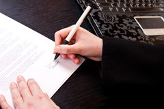 Close-up of signing papers Stock Images