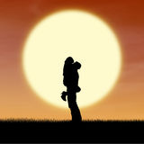 Close up silhouette of couple by orange sunset Royalty Free Stock Images