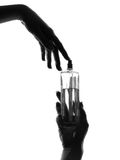 Close-up silhouette woman hands perfume Stock Photo