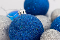 Close up of silver and blue shiny Christmas balls. On white background stock photography