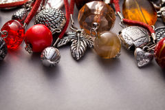 Close up of silver charms and glass beads Stock Images