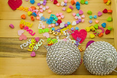 Close up silver disco ball and heart – shaped paper for Christ Stock Image