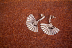 Close up of silver earrings Royalty Free Stock Photography