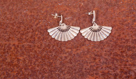 Close up of silver earrings Stock Images