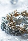 Close up of a silver and golden christmas decoration royalty free stock photos