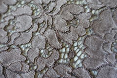 Closeup of silver guipure lacy fabric Royalty Free Stock Photography