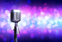 Close up of silver mic on glowing background. Close up of silver microphone, isolated on glowing background. Concept of music and arts stock photos