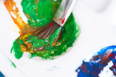 Close-up of paint brush and palette. Close-up of silver paint brush and palette Stock Photos
