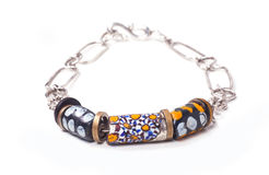 Close up of silver and painted stone necklace Stock Photos