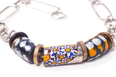 Close up of silver and painted stone necklace Royalty Free Stock Photography