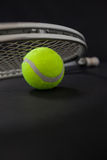 Close up of silver racket on tennis ball Stock Image