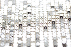 Close up of silver sequined textile texture Stock Images